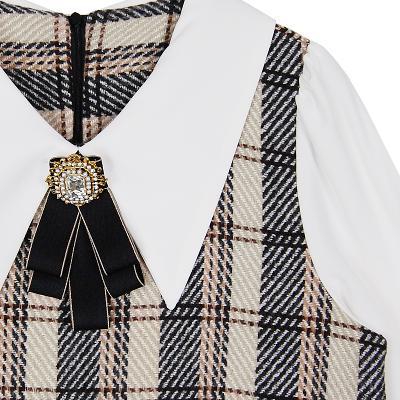 broach shirt layered dress brown